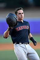 Catcher Devan Peterson (33) of the Harvard Crimson crosses home plate after hitting a home run in game two of a doubleheader against the Furman Paladins on Friday, March 16, 2018, at Latham Baseball Stadium on the Furman University campus in Greenville, South Carolina. Furman won, 7-6. (Tom Priddy/Four Seam Images)