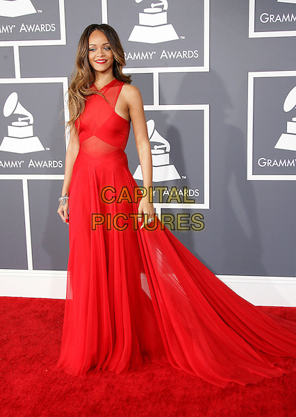 Rihanna (Robyn Rihanna Fenty).The 55th Annual GRAMMY Awards held at STAPLES Center, Los Angeles, California, USA..February 10th, 2013.grammys full length red sheer sleeveless dress    .CAP/ADM.©AdMedia/Capital Pictures.