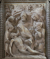 The Lamentation, high relief in stone, 1572, in the Collegiate Church of Saint-Gervais-Saint-Protais, built 12th to 16th centuries in Gothic and Renaissance styles, in Gisors, Eure, Haute-Normandie, France. The church was consecrated in 1119 by Calixtus II but the nave was rebuilt from 1160 after a fire. The church was listed as a historic monument in 1840. Picture by Manuel Cohen