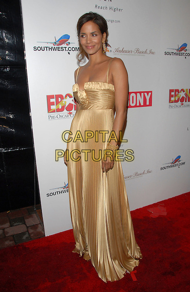 HALLE BERRY.Attends The 2007 Ebony Pre-Oscar Celebration held at The Jim Henson Studios in Hollywood, California, USA, February 22nd 2007..full length gold pleated silk satin dress.CAP/DVS.©Debbie VanStory/Capital Pictures