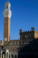 Torre del Mangia sticking out of the rooftops, Siena, Italy.
