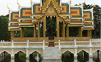 The island of Bang Pa-In, about 45 miles north of Bangkok, has been a summer royal retreat since 1632 and, in the late 19th century, King Rama V erected there a palace composed of a Chinese pagoda, a Swiss chalet, a boat house and numerous baroque pavilions, as well as this Thai-style temple, all set in expansive gardens and lakes.