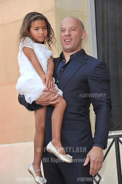 Vin Diesel &amp; daughter on Hollywood Blvd where he was honored with the 2,504th star on the Hollwood Walk of Fame.<br /> August 26, 2013  Los Angeles, CA<br /> Picture: Paul Smith / Featureflash