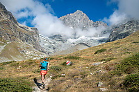 Trail running above Zermatt, with views of the Obergabelhorn, on the last day of the Via Valais, a multi-day trail running tour connecting Verbier with Zermatt, Switzerland.