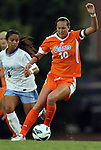 24 August 2012: Florida's Holly King (10) and UNC's Bianca Gray (4). The University of North Carolina Tar Heels played the University of Florida Gators to a 0-0 overtime tie at Fetzer Field in Chapel Hill, North Carolina in a 2012 NCAA Division I Women's Soccer game.