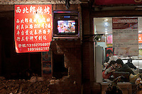 A Chinese couple shares a light moment at an old restaurant adjacent to a torn down building in central    Shanghai, China on November 05, 2009.