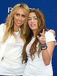 LOS ANGELES, CA. - May 09: Tish Cyrus and Miley Cyrus arrive at the 16th Annual EIF Revlon Run/Walk For Women at the Los Angeles Memorial Coliseum on May 9, 2009 in Los Angeles, California.