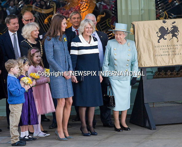 """KATE JOINS QUEEN AND CAMILLA FOR OFFICIAL ENGAGEMENT.The Royal Ladies undertook their first joint engagement when they visited Fortnum & Mason, where the Queen opened a new restaurant..The Queen later unveiled a plaque commenorating her Diamond Jubliee. .In celebration of St. David's Day, the royal ladies were then presented with posys of daffodils_London_01/03/2012.Mandatory Credit Photo: ©FRANCIS DIAS-NEWSPIX INTERNATIONAL..**ALL FEES PAYABLE TO: """"NEWSPIX INTERNATIONAL""""**..IMMEDIATE CONFIRMATION OF USAGE REQUIRED:.Newspix International, 31 Chinnery Hill, Bishop's Stortford, ENGLAND CM23 3PS.Tel:+441279 324672  ; Fax: +441279656877.Mobile:  07775681153.e-mail: info@newspixinternational.co.uk"""