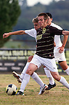 Palos Verdes, CA 01/22/13 - Chase Abelson (Peninsula #7) and Michael Johnson  (West Torrance #8) in action during the West vs Peninsula boys varsity soccer game at Peninsula High School.