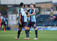 Garry Thompson of Wycombe Wanderers and Aaron Amadi Holloway of Wycombe Wanderers celebrates as Stephane Zubar of York scores an OG during the Sky Bet League 2 match between Wycombe Wanderers and York City at Adams Park, High Wycombe, England on 8 August 2015. Photo by Andy Rowland.