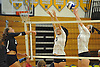 Massapequa No. 3 Joie Landy, center, and teammate 13 Mackenzie Byrne defend against a spike attempt by Plainview JFK No. 5 Maria Coniglio during a Nassau County varsity girls' volleyball game at Massapequa High School on Wednesday, September 9, 2015. Massapequa rallied from a 19-10 deficit in the first set to win 25-21, 25-14, 25-16.<br /> <br /> James Escher