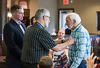 NWA Democrat-Gazette/BEN GOFF @NWABENGOFF<br /> Cpl. Aaron Mankin (from left), a U.S. Marine Corps Iraq veteran, and David 'Doc' Kenser, veteran services coordinator with Arkansas Hospice and a vietnam era U.S. Air Force veteran, recognize Ken Smith, who served in the U.S. Army from 1953-55, Tuesday, June 4, 2019, during a pinning ceremony for military veterans at Primrose Retirement Communities Assisted Living in Rogers. The program recognized 32 local veterans, most of whom are residents of the facility. The recognition is part of Arkansas Hospice's We Honor Veterans campaign to pay respect to veterans in their later years. Mankin, who works with congressman Steve Womack's office, also shared his story of surviving a bomb blast in Iraq in 2015.