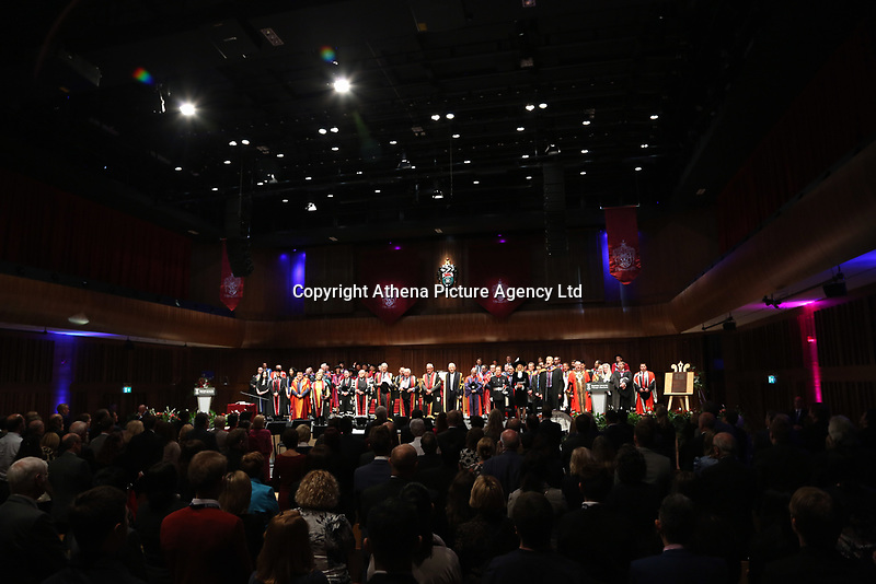 Pictured: The congregation stand for the welsh national anthem at Swansea University Bay Campus. Saturday 14 October 2017<br /> Re: Hillary Clinton, the former US secretary of state and 2016 American presidential candidate will be presented with an honorary doctorate during a ceremony at Swansea University's Bay Campus in Wales, UK, to recognise her commitment to promoting the rights of families and children around the world.<br /> Mrs Clinton's great grandparents were from south Wales.