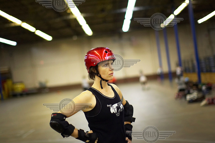 Miss Mary Smack at a roller derby practice in Wilmington, Massachusetts. Roller derby is an American contact sport, popular with young women, which combines both athleticism and a satirical punk third-wave feminism aesthetic.