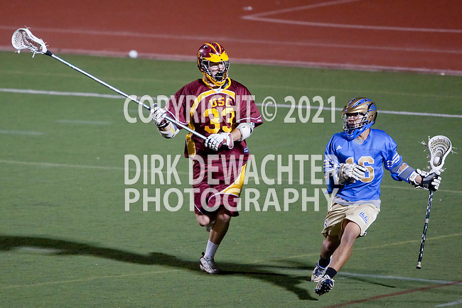 Los Angeles, CA 04/24/10 - Jacob Pontes (USC # 33) and Victor Poon (UCLA # 16) in action during the UCLA-USC game at Cromwell Field on USC's campus, UCLA edged crosstown rival USC 10-9.