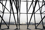 Members of the media look at a Japan Airlines Corp. 747 passenger plane during an engine test prior to a demonstration flight that utilized sustainable fuel in one engine in Tokyo, Japan.