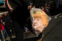NEW YORK, NY - APRIL 16: A man carries a mask of U.S. president Trump as he attends the Annual Easter parade on April 16, 2017 in New York City.  The Easter Parade and Easter Bonnet Festival is characterized by revelers dressed in their holiday finery, which typically includes handmade hats, while they gather around St. Patrick's Cathedral to show their creations. Photo by VIEWpress/Eduardo MunozAlvarez