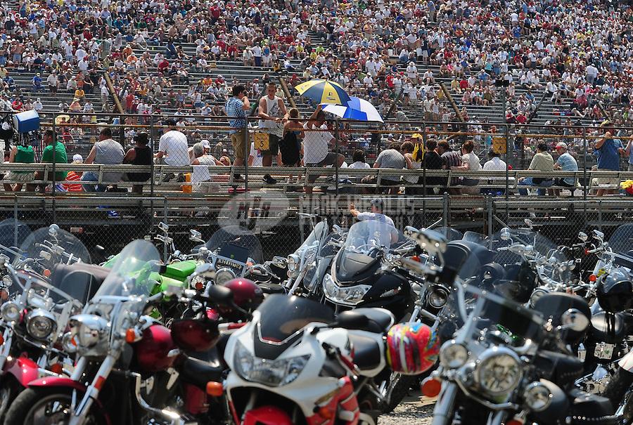 May 30, 2010; Indianapolis, IN, USA; IndyCar Series fans watch the race during the Indianapolis 500 at the Indianapolis Motor Speedway. Mandatory Credit: Mark J. Rebilas-