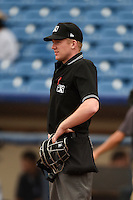 Home plate umpire Matt Winter during a game between the Dayton Dragons and Lake County Captains on June 8, 2014 at Classic Park in Eastlake, Ohio.  Lake County defeated Dayton 4-2.  (Mike Janes/Four Seam Images)