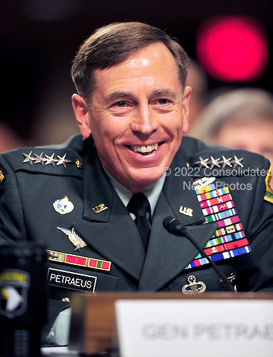 General David H. Petraeus, U.S. Army, smiles as he testifies before the United States Senate Armed Services Committee hearing on his nomination to be commander of the International Security Assistance Force and commander of the United States Forces in Afghanistan in Washington, D.C. on Tuesday, June 29, 2010..Credit: Ron Sachs / CNP