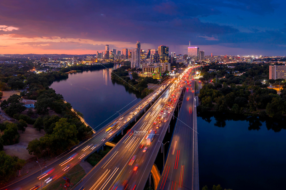 Colorful sunset over the Austin skyline as IH-35 traffic flows through downtown. Austin boast the most congested traffic in the State of Texas from the city that never sleeps.