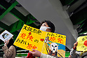 Tokyo, Japan - April 15: A woman held a sign against Oi Nuclear Power Plant in Fukui during a demonstration at streets of Ikebukuro, Toshima, Tokyo, Japan on April 15, 2012. The plant had been suspended to produce electricity for its safety check, but Japanese Government and Kansai Electric Power Company, or KEPCO, confirmed it safe recently.