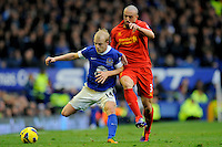28.10.2012 Liverpool, England.  Steven Naismith  and Jose Enrique of Liverpool   in action during the Premier League game between Everton and Liverpool  from Goodison Park ,Liverpool