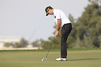 Marcus Fraser (AUS) putts on the 12th green during Sunday's Final Round of the Commercial Bank Qatar Masters 2013 at Doha Golf Club, Doha, Qatar 26th January 2013 .Photo Eoin Clarke/www.golffile.ie