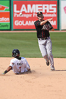 Quad Cities River Bandits shortstop Thomas Lindauer (1) turns a double play as Gregory Munoz (7) slides in during a game against the Wisconsin Timber Rattlers on May 2nd, 2015 at Fox Cities Stadium in Appleton, Wisconsin.  Quad Cities defeated Wisconsin 5-2.  (Brad Krause/Four Seam Images)