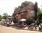 People sitting outside Adam and Eve pub, the oldest in Norwich, Norfolk, England