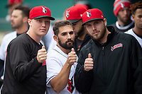 Indianapolis Indians catcher Christian Kelley (26) celebrates with Mitch Keller (18) and Alex McRae (37) after scoring a run during an International League game against the Columbus Clippers on April 30, 2019 at Victory Field in Indianapolis, Indiana. Columbus defeated Indianapolis 7-6. (Zachary Lucy/Four Seam Images)