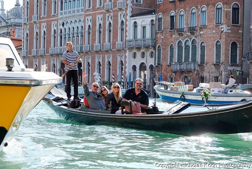 Four people in our group, (L to R)   Aaron Pederson, Rachel Cantella-McNamara, Ronna Sorensen and Ken Sorenson enjoy a Gondola ride in Venice.