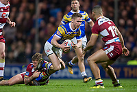 Picture by Allan McKenzie/SWpix.com - 13/04/2018 - Rugby League - Betfred Super League - Leeds Rhinos v Wigan Warriors - Headingley Carnegie Stadium, Leeds, England - Leeds's Matt Parcell is tackled by Wigan's Ryan Sutton.