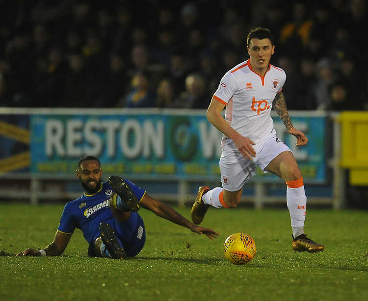Blackpool's Callum Cooke goes past AFC Wimbledon's Liam Trotter<br /> <br /> Photographer Kevin Barnes/CameraSport<br /> <br /> The EFL Sky Bet League One - AFC Wimbledon v Blackpool - Saturday 20th January 2018 - Kingsmeadow Stadium - London<br /> <br /> World Copyright &copy; 2018 CameraSport. All rights reserved. 43 Linden Ave. Countesthorpe. Leicester. England. LE8 5PG - Tel: +44 (0) 116 277 4147 - admin@camerasport.com - www.camerasport.com