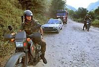 - Kosovo, Italian soldiers escort the Albanian cars that  transit in front of orthodox convent of Deciani<br /> <br /> <br /> <br /> - Kossovo, militari italiani scortano le auto albanesi che transitano davanti al convento ortodosso di Deciani