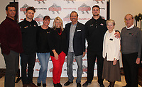 Sam Davis (from left), Ashtyn Davis, Christine Cohen, Vickie and Marty Burslworth, Kenny Willekes, Burlworth Trophy winner, and Mary and Ken Wiersma gather Oct. 8 at the Apollo on Emma in Springdale for a Burlsworth Foundation reception on the eve of the the award presentation luncheon. Ashtyn and Rodrigo Blankenship were also finalists for the award.<br /> (NWA Democrat-Gazette/Carin Schoppmeyer)