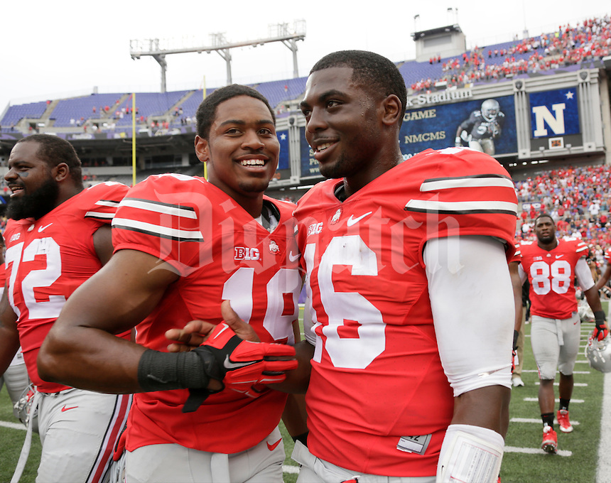 Ohio State Buckeyes wide receiver Joe Ramstetter (19) and Ohio State Buckeyes quarterback J.T. Barrett (16) celebrate a 34-17 win over Navy in Saturday's NCAA Division I football game at M&T Bank Stadium in Baltimore on August 30, 2014. (Dispatch Photo by Barbara J. Perenic)