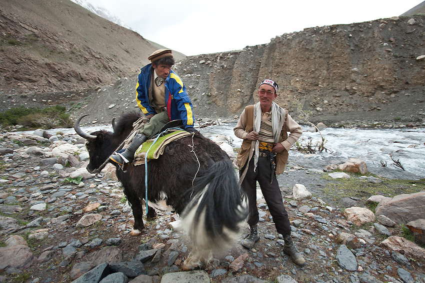 A Wakhi man riding a yak. Trekking up and along the Wakhan river, the only way to reach the high altitude Little Pamir plateau, home of the Afghan Kyrgyz community.