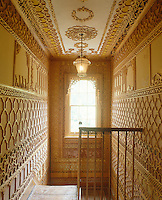 The fretwork panels on the landing feature a diverse range of influences from moorish architecture to ancient African designs