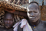 18 december 2010 - Juba, Southern Sudan - Members of the Dinka tribe from Bor, Jonglei State before the final of South Sudan's first commercial wrestling league between their tribe and the Mundari wrestlers from Central Equatoria State at Juba Stadium. The matches attracted large numbers of spectators who sang, played drums and danced in support of their favorite wrestlers. The match organizers hoped that the traditional sport would bring together South Sudan's many different tribes. Photo credit: Benedicte Desrus