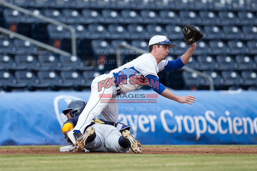 Duke Blue Devils third baseman Max Miller (5) shows the umpire the ball after putting the tag on Aaron Knapp (23) of the California Golden Bears at Durham Bulls Athletic Park on February 20, 2016 in Durham, North Carolina.  The Blue Devils defeated the Golden Bears 6-5 in 10 innings.  (Brian Westerholt/Four Seam Images)