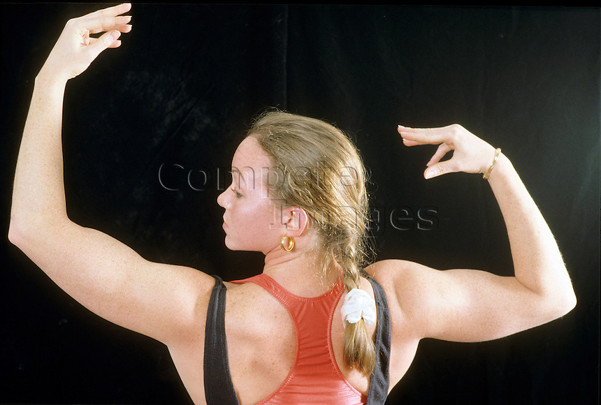 Woman displaying muscle tone of upper back