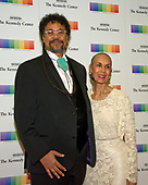 Carmen de LaVallade and her son, Leo Holder, arrive for the formal Artist's Dinner honoring the recipients of the 40th Annual Kennedy Center Honors hosted by United States Secretary of State Rex Tillerson at the US Department of State in Washington, D.C. on Saturday, December 2, 2017. The 2017 honorees are: American dancer and choreographer Carmen de Lavallade; Cuban American singer-songwriter and actress Gloria Estefan; American hip hop artist and entertainment icon LL COOL J; American television writer and producer Norman Lear; and American musician and record producer Lionel Richie.  <br /> Credit: Ron Sachs / Pool via CNP