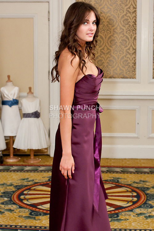 Model walks in a plum duchess satin floor length dress with draped bodice, a-line, bias skirt and plum ribbon sash, by from the Watters Fall 2010 Bridal Collection, during the Wedding Channel Couture Show Fall 2010.