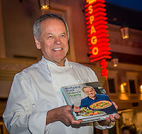 LAS VEGAS, NV - April 9 : Wolfgang Puck signs copies of, Wolfgang Puck Makes It Healthy: Light, Delicious Recipes and Easy Exercises for a Better Life, at Spago at Caesars Palace in Las Vegas, NV on April 9, 2014. Kabik/Starlitepics
