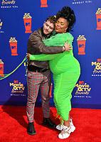 SANTA MONICA, USA. June 16, 2019: Bazzi & Lizzo at the 2019 MTV Movie & TV Awards at Barker Hangar, Santa Monica.<br /> Picture: Paul Smith/Featureflash