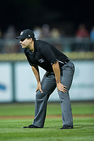Umpire Edgar Huerta-Morales handles the calls on the bases during the Pioneer League game between the Missoula Osprey and the Billings Mustangs at Dehler Park on August 21, 2017 in Billings, Montana.  The Osprey defeated the Mustangs 10-4.  (Brian Westerholt/Four Seam Images)