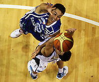 Saints guard Troy McLean and Giants guard Josh Bloxham compete for the ball during the NBL Round 2 basketball match between the Wellington Saints and Nelson Giants at TSB Bank Arena, Wellington, New Zealand on Thursday 19 March 2009. Photo: Dave Lintott / lintottphoto.co.nz