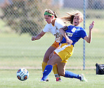 BROOKINGS, SD - OCTOBER 18: Roxy Roemer #4 from North Dakota State battles for the ball with Ashley Adams #9 from South Dakota State during their game Sunday afternoon at Fischback Soccer Field in Brookings. (Photo by Dave Eggen/Inertia)