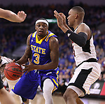 SIOUX FALLS, SD: MARCH 7: Chris Howell #3 of South Dakota State drives toward Tre'Shawn Thurman #15 of Omaha during the Men's Summit League Basketball Championship Game on March 7, 2017 at the Denny Sanford Premier Center in Sioux Falls, SD. (Photo by Dick Carlson/Inertia)